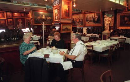 Helen Burton (left) and her husband, the Rev. Albert Burton, of Rock Hall take Kay Anthony of Ponca City, Okla., to lunch in Haussner's dining room in 1999.