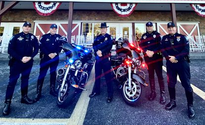 Bel Air Police Chief Charles Moore, center, stands with Bel Air's four motorcycle operators and its two new motorcycles from Eisenhauer's Chesapeake Harley Davidson in Darlington. Pete and Ramsey Eisenhauer donated one of the bikes, valued at about $17,000.