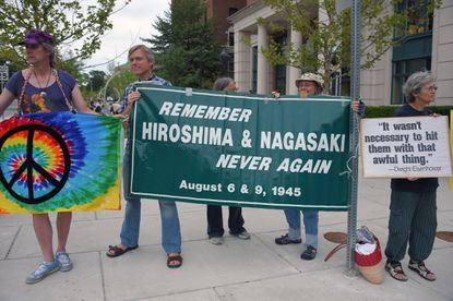 Protesters stand on 33rd St and Charles Street during the annual remembrance of the 1945 atomic bombings of Hiroshima (Aug. 6) and Nagasaki (Aug. 9), held near Johns Hopkins University in 2015. File.