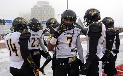 Towson Tigers safety Jordan Love (7) warms up before a game against the Eastern Washington Eagles at Roos Field.