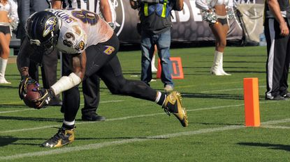 A pass from Ravens quarterback Joe Flacco goes too far for wide receiver Steve Smith Sr. (89), who cannot keep both feet inbounds on a pass in the end zone during the fourth quarter.
