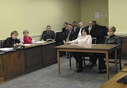 Harford interim School Superintendent Barbara Canavan, seated center, discusses education issues with the county's delegates and senators in Annapolis Friday. School Board President Nancy Reynolds is to her left.