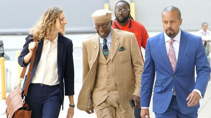 Sen. Nathaniel Oaks, center, along with his attorneys walk into federal court for his sentencing in 2018.