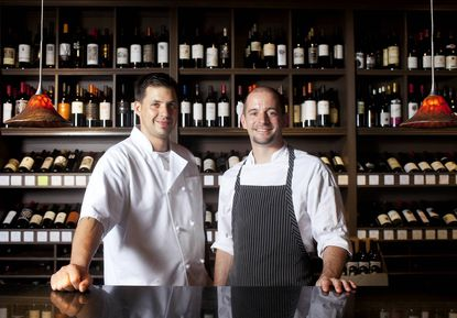Sous Chef Bryan Boessel, left, and Executive Chef Chris Lewis of Iron Bridge Wine Company make it a point to use ingredients from local farms.