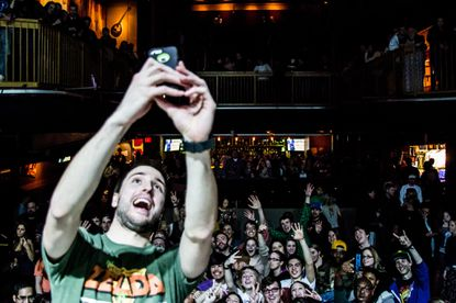 Stacked Like Pancakes singer Kellen McKay poses for a selfie with the Rams Head Live audience at the ska band'sMarch 21 show.