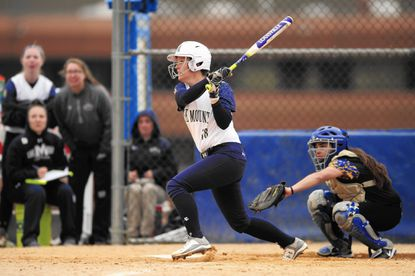 Mount St. Mary's Holly Buckel, a North Carroll grad, bats against Coppin State on March 12. After dealing with a torn ACL and a torn labrum in her shoulder twice in her career, she plays with the nagging injury and refuses to let her pain get the better of her. (Photo Courtesy of Mount St. Mary's University)