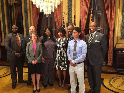 Mayor Catherine Pugh poses with several of her appointees to the Civilian Oversight Task Force at City Hall on Tuesday. The task force was mandated by the city's consent decree with the U.S. Department of Justice and is tasked with reviewing and recommending reforms to the current process for civilian oversight of the Baltimore Police Department. From left: Marvin McKenstry, Daniel Levine, Denise Duval, Valencia Johnson, Pugh, Ralph Hughes, Andrew Reinel and Edward Jackson.