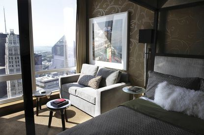 The bedroom of the HGTV Urban Oasis condo features hand-painted walls by Chicago artist Michael Boudreault.