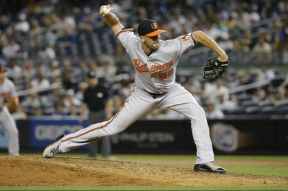 Baltimore Orioles' Darren O'Day delivers a pitch during the eighth inning of a baseball game Wednesday, Sept. 9, 2015, in New York.