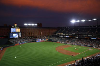 Dusk settles over Oriole Park at Camden Yards as members of the Baltimore Orioles and Toronto Blue Jays play on  April 5, 2017.
