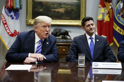 Sept. 5, 2018: Then Speaker of the House Rep. Paul Ryan, R-Wis., listens to President Donald Trump speak during a meeting with Republican lawmakers in the Roosevelt Room of the White House in Washington.