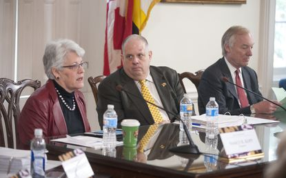 Maryland's spending panel is slated to authorize paying out $369,000 to settle separate claims of mistreatment of three state employees at their workplaces. In this file photo, State Treasurer Nancy Kopp speaks at a Maryland Board of Public Works meeting at the State House in Annapolis, with Gov. Larry Hogan, center, and State Comptroller Peter Franchot, right.