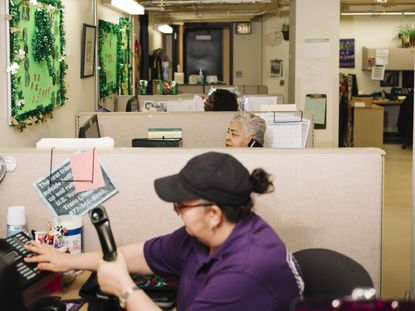 Women work at a domestic violence hotline in Chicago, March 20, 2020. President Joe Biden's $1.9 trillion pandemic relief package inclludes tens of millions of dollars for organizations dedicated to curtailing domestic abuse, which skyrocketed during the pandemic.