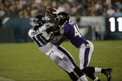 Philadelphia Eagles' Quron Pratt is hit by Baltimore Ravens' Cassius Vaughn during the second half of a preseason NFL football game, Saturday, Aug. 22, 2015, in Philadelphia. Vaughn was cut by the Ravens after training camp but was re-signed this week.