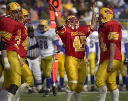 On Nov. 23, 2000, Calvert Hall and Loyola met at then-PSI Net Stadium (now M&T Bank Stadium), for their annual Turkey Bowl. Calvert Hall won the game in overtime, 7-6. Rico Ramires (45) celebrates after the Calvert Hall touchdown.