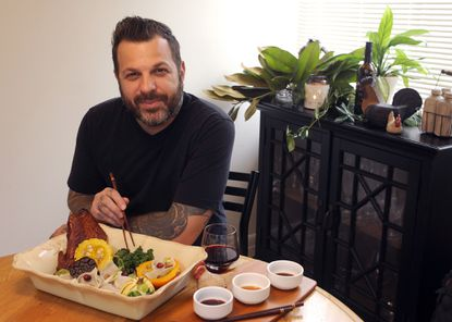 The chef Cyrus Keefer posed with the Thanksgiving dish he created for a 2014 Baltimore Sun feature story.