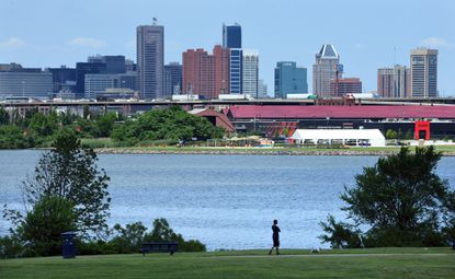 The Baltimore city skyline is seen from Middle Branch Park on the Patapsco River in South Baltimore.