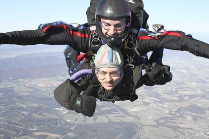 Robert Zerance, on bottom, gives the ¿thumbs up¿ sign while skydiving with tandem instructor Jamie Sides from the Chambersburg Skydiving Center on Nov. 5.