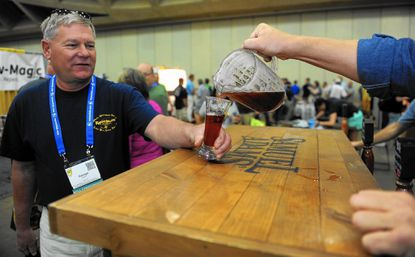George Sheffer of York, Pa. samples a glass of Samuel Adams at Homebrew Con, a convention of home-brewed beer enthusiasts held at the Baltimore Convention Center.