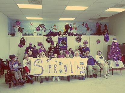 The staff and many of the clients at West End Place Adult Day Care in Westminster show off their Purple Pride the day after the Ravens won Super Bowl XLVII.