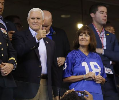 Vice President Mike Pence reacts to fans before an NFL football game between the Indianapolis Colts and the San Francisco 49ers, Sunday, in Indianapolis.