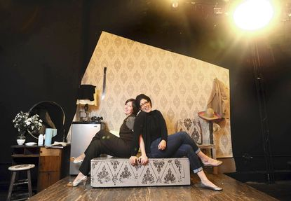 "The Strand Theatre's new directors Rain Pryor (right) and Elena Kostakis appear on the set of the Strand's current production, ""That Pretty Pretty; or, The Rape Play."""
