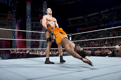 WWE Superstar Cesaro swings his opponent, Kofi Kingston, during a recent match.