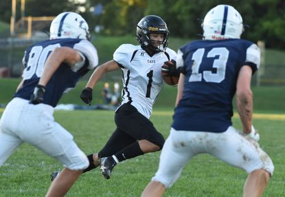 South Carroll's Antonio Rodrigues sets his sights on the endzone as he outruns a pair of Manchester Valley defenders for a touchdown during a football game at Manchester Valley High School on Friday, Sept. 24, 2021.
