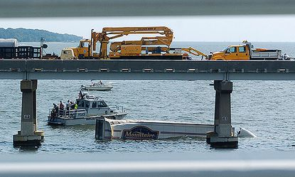 The driver of a tractor-trailer was killed after a three-vehicle collision that caused the 18-wheeler to plunge into the Chesapeake Bay from the Bay Bridge.