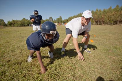 Two St. Paul's football players learn a lesson from teaching their sport in Kenya