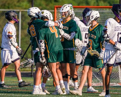 Wilde Lake celebrates a goal by Lucas Michel (4) during a boys lacrosse game at Long Reach on May 21, 2021.
