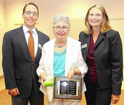 Louise LeTendre, center, was honored Thursday for her 10 years of service on the Harford County Board of Library Trustees. With her are board chairperson Alex Allman and Library Director Mary Hastler. LeTendre left the board last month.
