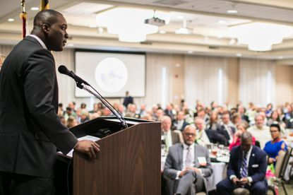 Howard County Executive Calvin Ball delivers his address to a room of almost 500 people at Turf Valley in 2019.