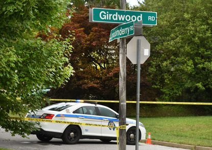 Crash team investigators were on Girdwood Road at the intersection of Londonderry Road where a DUI driver is alleged to have killed a woman and a child.