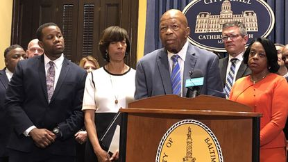 Mayor Catherine Pugh and U.S. Rep. Elijah Cummings announce grants from BlueCross BlueShield to help boost addiction treatment efforts.