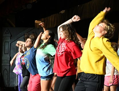 Campers in the Tidewater Players Junior Summer Camp perform one of the musical numbers from The Addams Family production during a camp session Thursday, July 8, 2021 at the Opera House in Havre de Grace.
