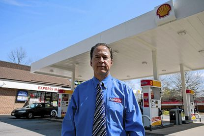 Rick Levitan stands in front of the Shell gas station he owns in the Owen Brown Village Center on Saturday, April 12. He's concerned about his business if Howard County doesn't update regulations.