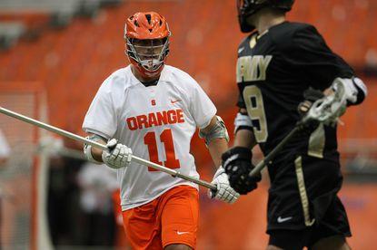 Syracuse defenseman Brian Megill and Army attackman Garrett Thul in the Orange's 10-9 win over visiting Army on Feb. 29.