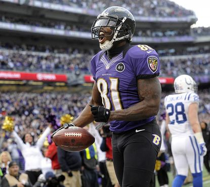 Wide receiver Anquan Boldin celebrates after scoring a touchdown in the second half of the Baltimore Ravens' AFC wild-card playoff win over the Indianapolis Colts at M&T Bank Stadium in Baltimore Sunday.