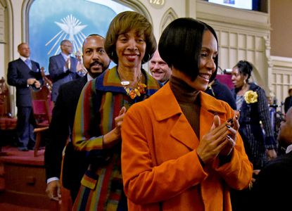 Actress Jada Pinkett Smith (right) invited Baltimore mayoral candidate Sen. Catherine Pugh (center) to attend Palm Sunday services with her at the church her family attends, Macedonia Baptist Church in West Baltimore.