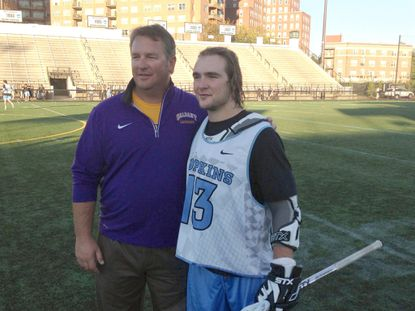 Albany lacrosse coach Scott Marr with his son, Kyle Marr, who plays for Johns Hopkins.