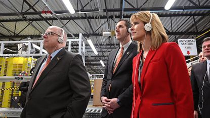 Left to right, Gov. Larry Hogan, Baltimore County Executive John Olszewski and Maryland Commerce Secretary Kelly Schulz tour the Sparrows Point Amazon fulfillment center, which received state job creation tax credits. A state audit found the Commerce Department has not verified that some projects receiving job-creation tax credits, all unnamed, actually created jobs.