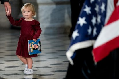 Rep. Eric Swalwell's daughter Kathryn pays her respects to Justice Ruth Bader Ginsburg as she lies in state in Statuary Hall of the U.S. Capitol on September 25 in Washington, D.C.