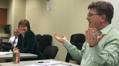 Sheila Ruth, left, and Tom Quirk, right, debate the issues during a candidate forum in Baltimore County for Councilmanic District 1.