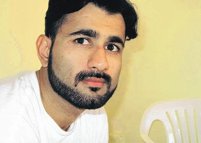 This Sept. 2009 photo, courtesy of the Center for Constitutional Rights, shows Majid Khan while imprisoned at the U.S. Navy base at Guantanamo Bay in Cuba.