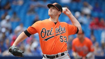 Orioles closer Zach Britton delivers a pitch in the eighth inning against the Toronto Blue Jays at Rogers Centre Saturday.