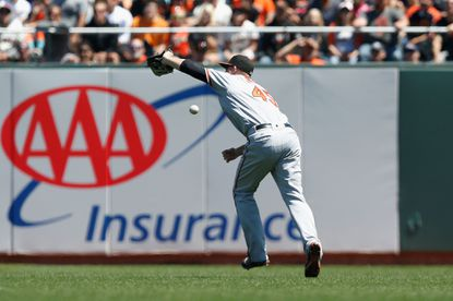 Mark Trumbo of the Baltimore Orioles drops a ball hit by Eduardo Nunez of the San Francisco Giants in the second inning during an interleague game at AT&T Park on Aug. 14, 2016 in San Francisco.