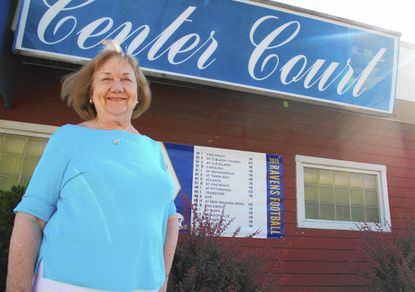 Shirley McCumbie stands in front of her Arbutus bar and package store, Center Court on Aug. 28. She is in the process of selling it to a new owner.
