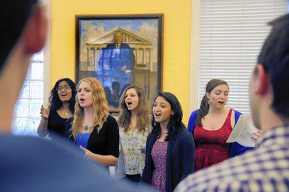 Female members of the acapella group The Octopodes rehearse at Johns Hopkins University's Homewood campus.