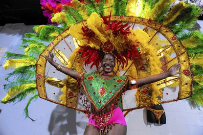Semaj James, 17, of Baltimore, models her female individual front line costume she will wear for the 2014 Baltimore/Washington One Caribbean Carnival parade.
